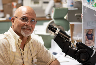 Optitian Richard Gonzalez working at his desk