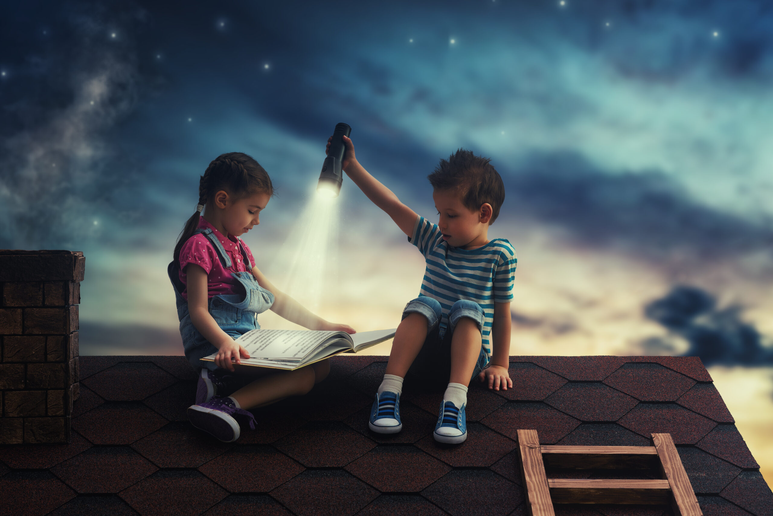 Children Reading A Book Sitting On The Roof